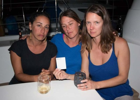 """Molly, Brenda, and Kristin wrapping their heads about the Cards Against Humanity """"wifely duties"""" card"""