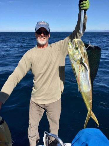 Capt. Fishguts landing a dorado off Bahía Tenacatita