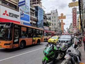 Scooters, buses, taxis dominate the streets