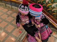 Hmong children selling the opportunity to take photos with them