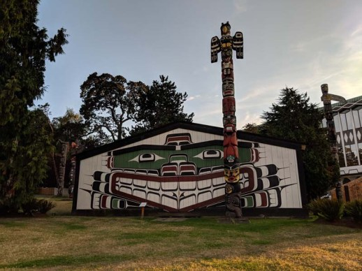 Totems and historic buildings at Thunderbird Park
