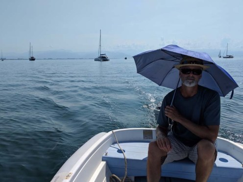 Prudent sun protection as we take the long dinghy ride to the marina