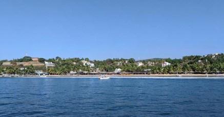 A panga about to make a run for the beach between sets at Caleta de Campos