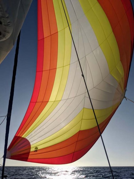 Flying the pretty sail on our crossing to Candeleros from Mazatlán
