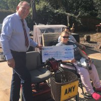 Highcliffe woman presented with mobility scooter after losing use of legs