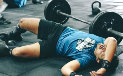 man resting between sets