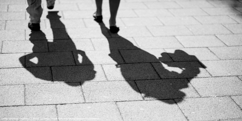 Policy Brief Image of Two Shadows from Walking Men Representing Shadow Economies