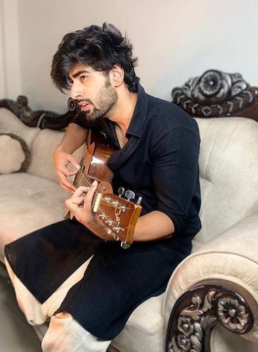 Mridul Madhok Playing the Guitar