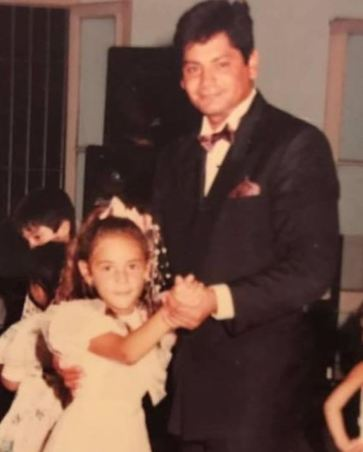 A childhood picture of Rocio Oliva with her father