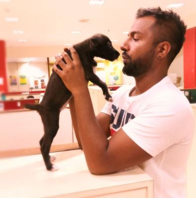 Suren Sundaram with a dog