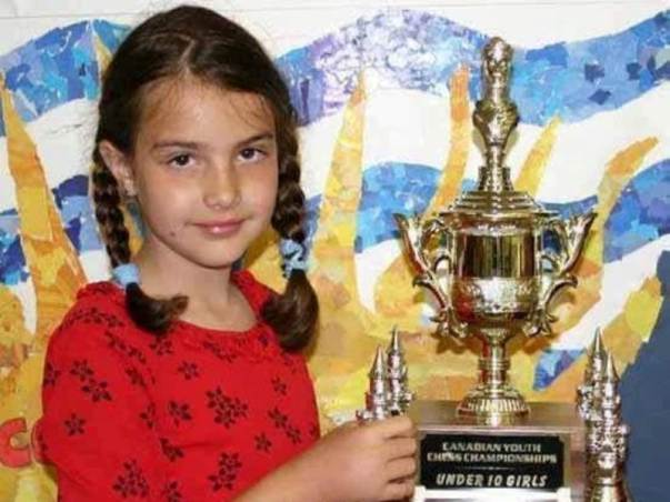 Alexandra Botez holding Canadian Youth Chess Championship trophy