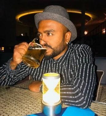 Raghu Gowda drinking beer