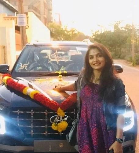 Divya Suresh with her car