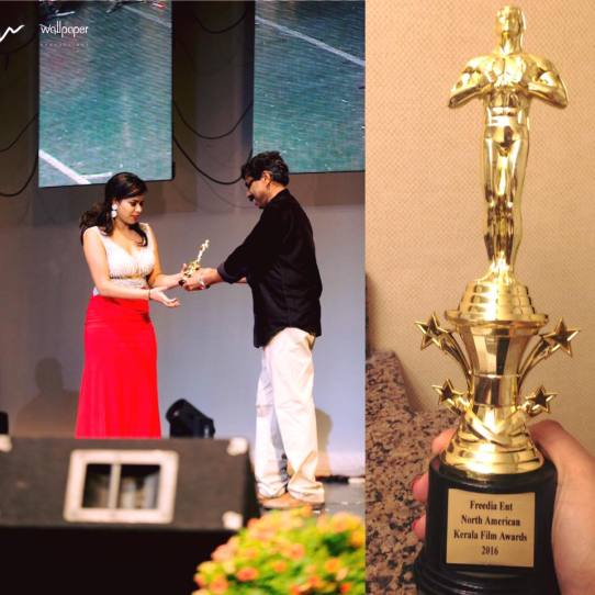 Michelle Ann Daniel receiving the Best Actress Award at North American Kerala Film Awards 2016