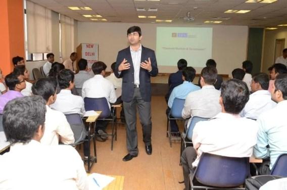 Varun Malhotra giving a lecture in NDIM