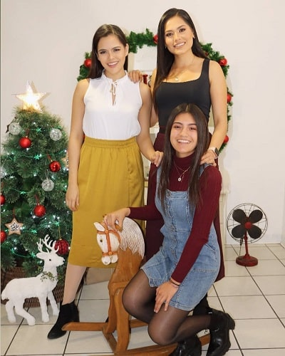 Andrea Meza and her sisters