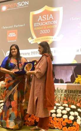 Savi Kumar with her Asia Education Summit & Award