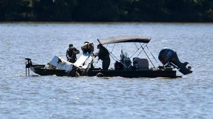 Emergency personnel removing debris of a plane crash from Percy Priest Lake in Smyrna, Tennessee