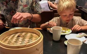 Peter and Sebastian eating dim sum at Din Tai Fung