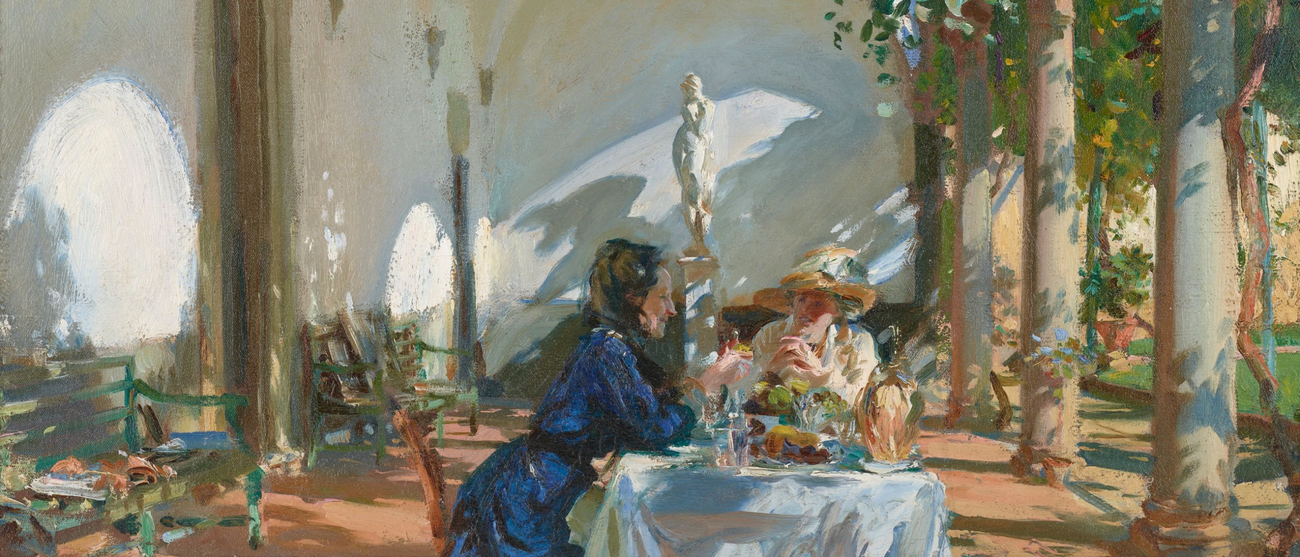 Two women breakfasting in a loggia, dappled with sunlight, described in colorful oil paint with brisk brushwork.