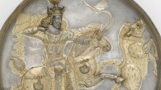 Detail of chased silver metalwork with gilding, depicting a Persian hunter on horseback nocking an arrow to shoot a boar.