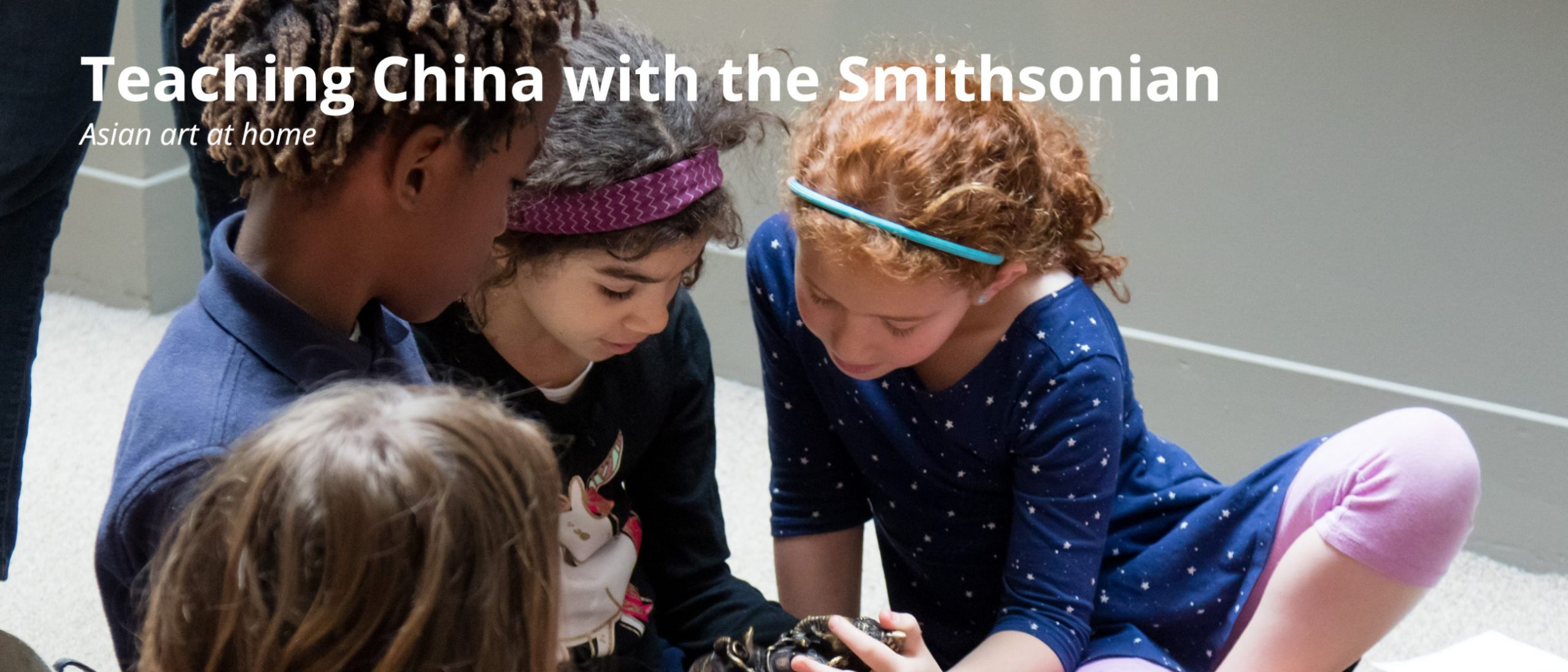 Teaching China with the Smithsonian - new resource. Image shows four children looking at a small bronze object.