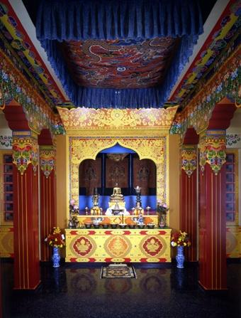 Tibetan Buddhist Alter - awash in golds, blues, and reds.