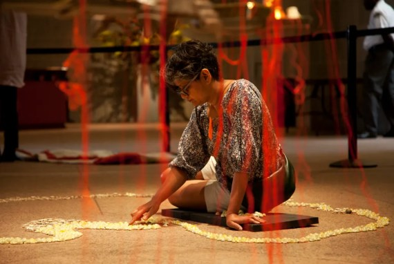 "Rina Banerjee installing ""A World Lost"" in the Sackler Paviion."