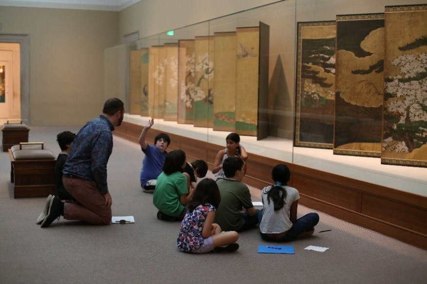 Matthew Lasnoski, youth and family programs educator, leads campers on a tour of the Freer's collection of Japanese art.