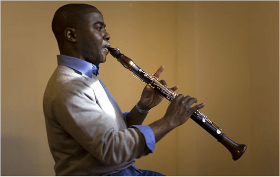 Clarinetist Anthony McGill faces right, holding clarinet.