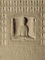 Detail of stone relief depicting the Buddha.