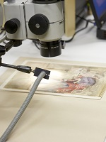 Magnification equipment focused on a folio page.