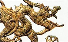 Detail of a cast, gilded dragon plaque.
