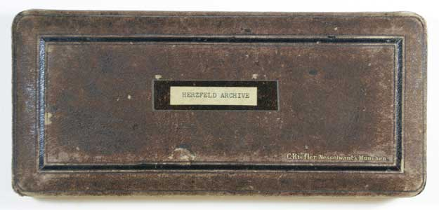 """Brown box lid with label: """"Herzfeld Archives"""""""