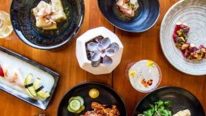 an array of colorful japanese dishes from Himitsu