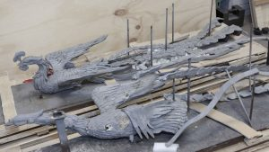 two phoenix sculptures from Nine Deaths, Two Births: Xu Bing's Phoenix Project