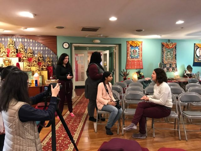 Teen Council members filming an interview with Alika Middleton, a lifelong member of the KPC temple