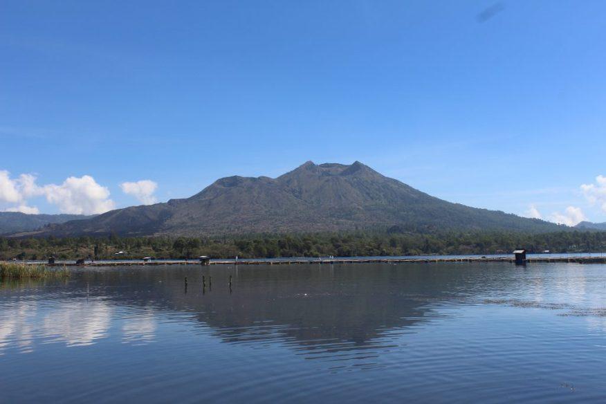 Double-corona volcano across a lake