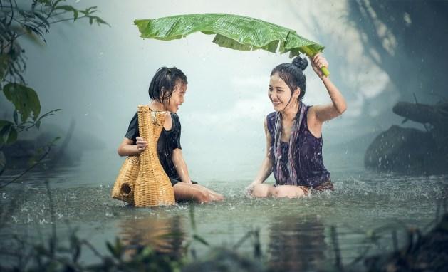 mother daughter in rain