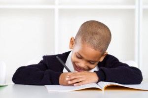 Kid with workbook: (c) Michaeljung   Dreamstime.com