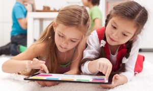 c-ilona75_dreamstime_com_young_girls_using_tablet.jpg
