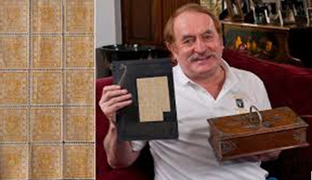 Allan Grant of Rushstamps with stamps and cigar box
