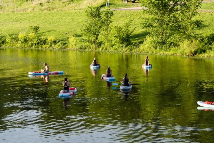 SUP Yoga Teacher on lake