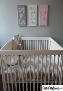 crib with pictures on the wall