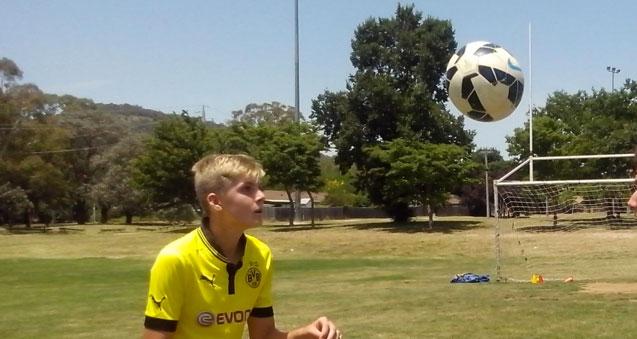 kid heading soccer ball