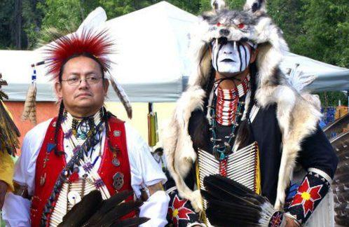 Midnight Sun Intertribal Pow Wow Facebook Page Two dancers at the Midnight Sun Intertribal Pow Wow, which takes place July 8-10 in Fairbanks, Alaska.