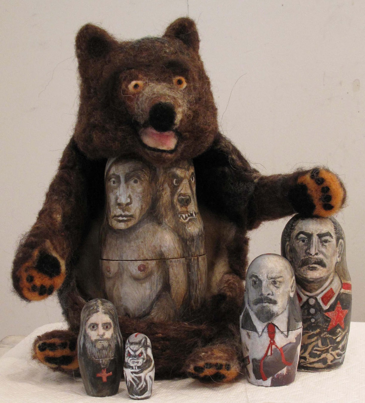 Bear (T)hugs, 2015, Lydia Bodnar-Balahutrak. Felted bear, 5 painted wooden nesting dolls. 10 x 14 x 6 inches.