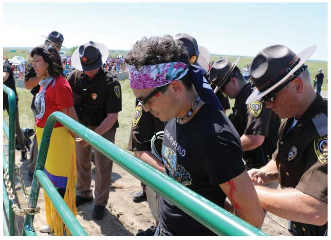 Scatter Their Own Juliana Brown Eyes-Clifford and Scotti Clifford get arrested during the Dakota Access Pipeline confrontation. Photo courtesy of Arlo Iron Cloud.