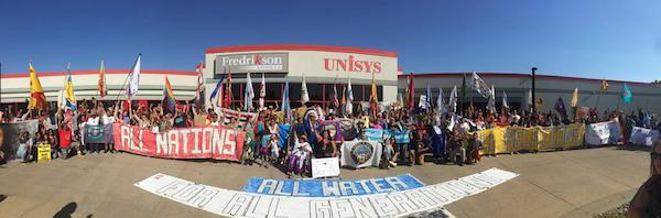 Courtesy Indigenous Environmental Network About 300 people rallied outside the Bismarck, North Dakota offices of Fredrikson & Byron, the attorneys representing the Dakota Access pipeline builders, on August 29.