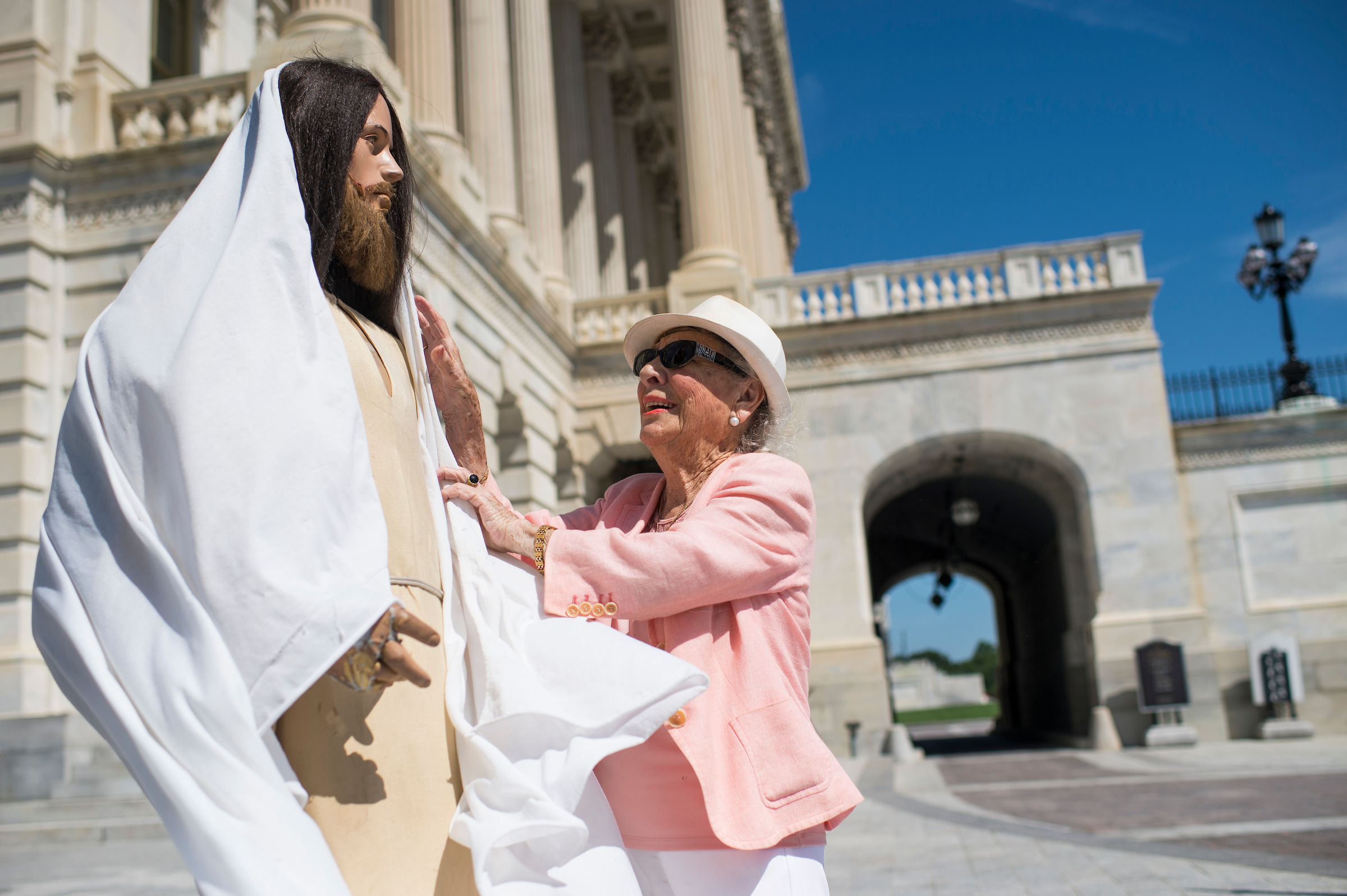 Rita Warren sets up her Jesus mannequin on the House side of the U.S. Capitol building on Thursday. (Bill Clark/CQ Roll Call).
